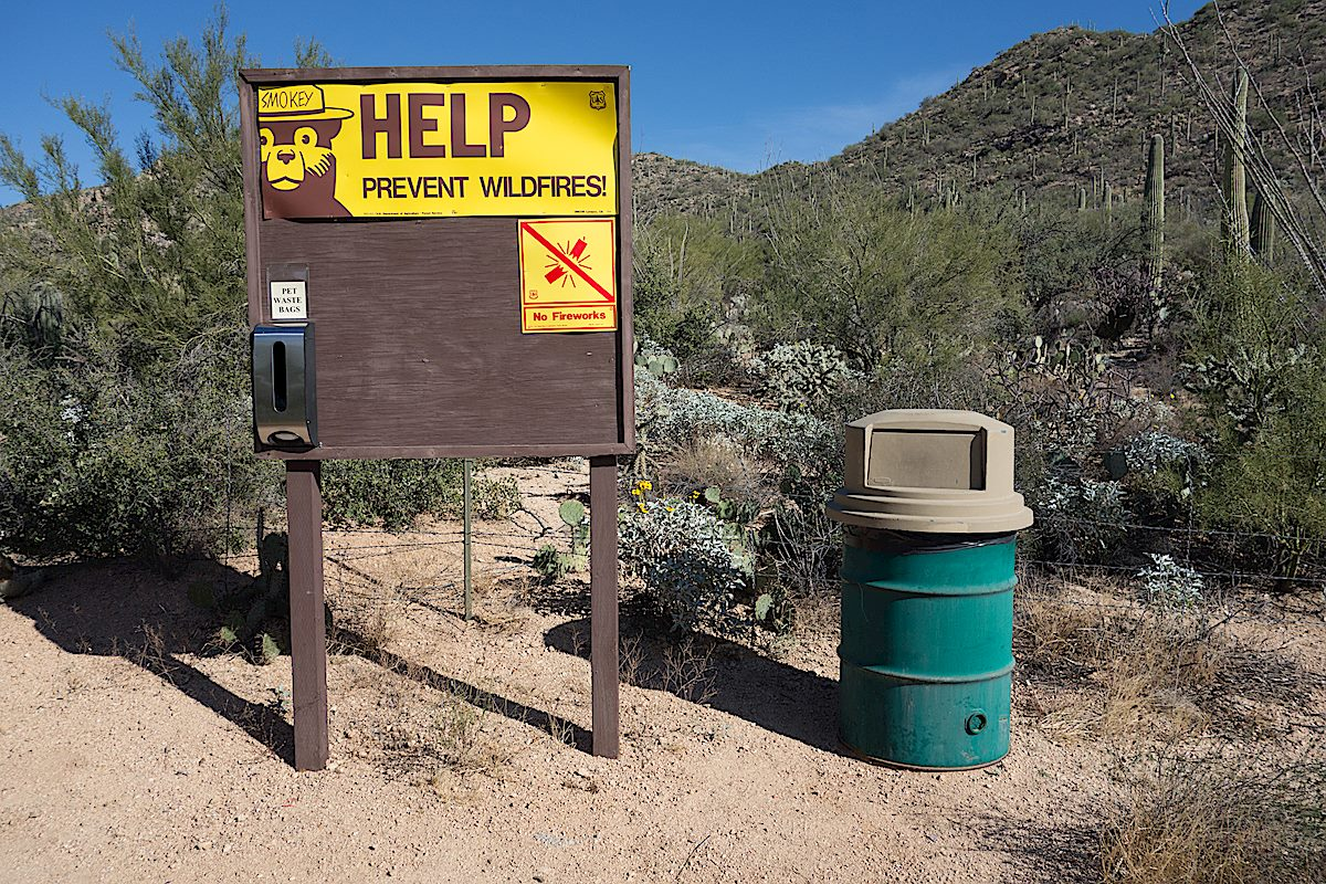 Signs and trashcan at the start of the trail. December 2014.