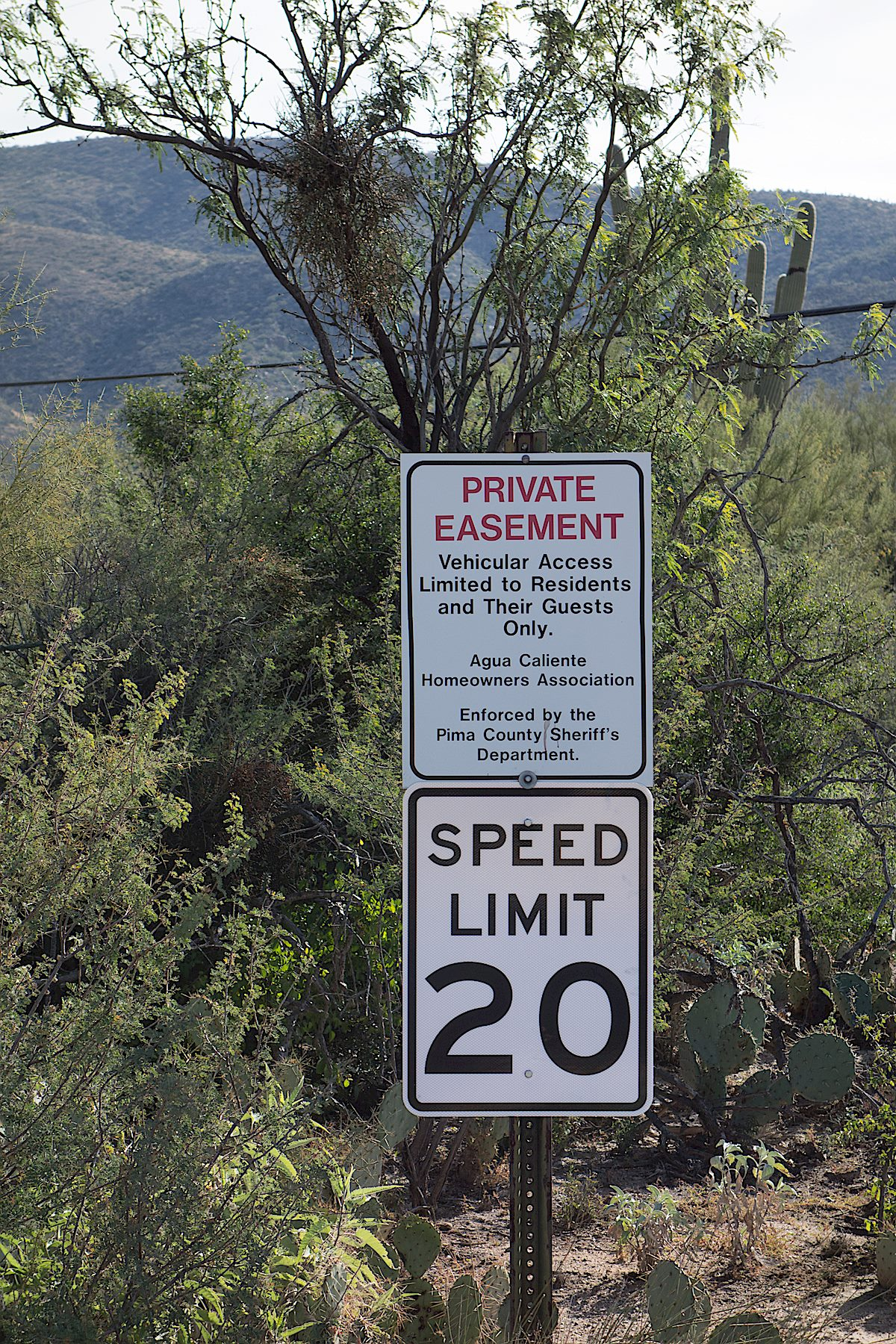 The Avenida de Suzenu Trailhead does not have any signage with the name of the trailhead - this Private Easement sign is one of the few details that hints that this is a well known parking area/trailhead. December 2014.