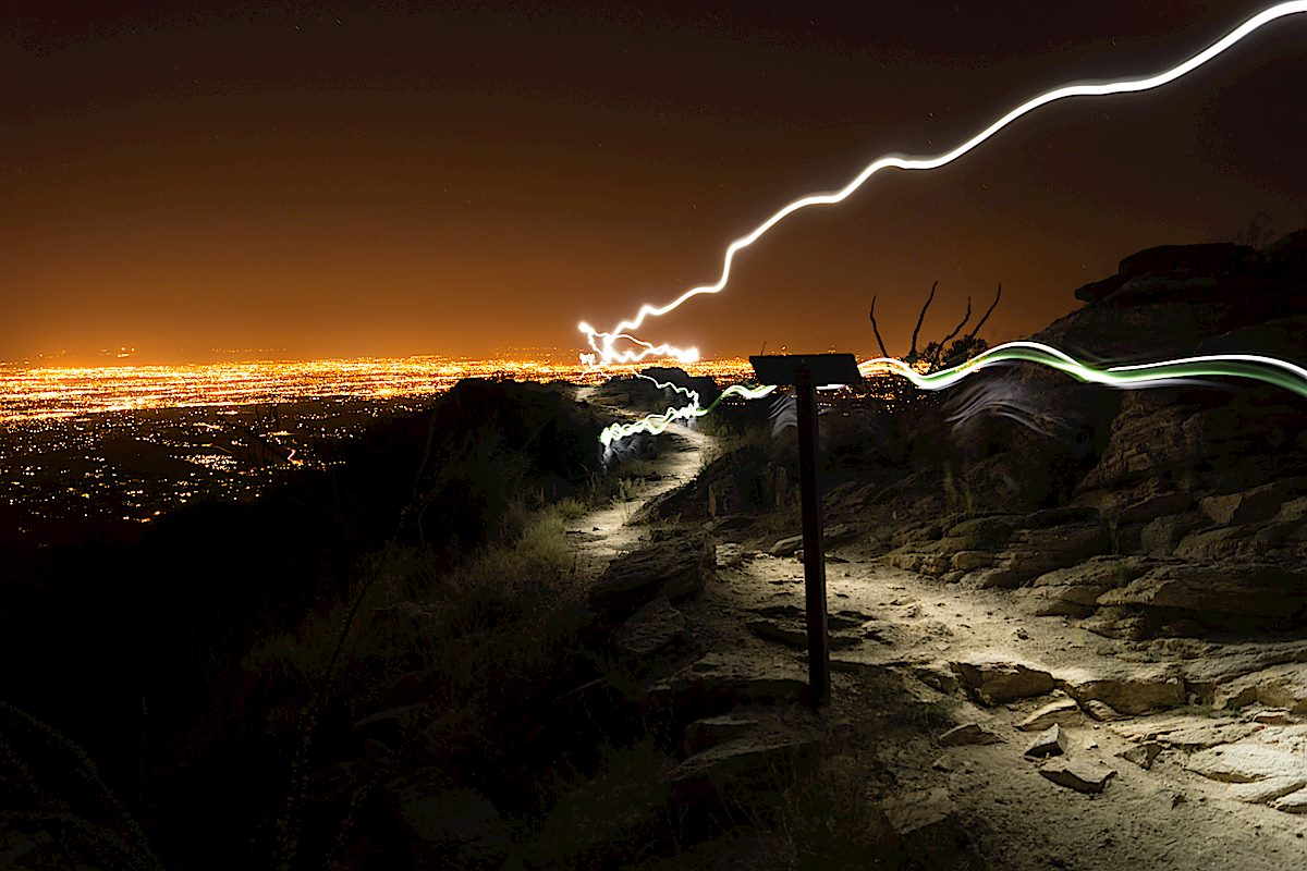 Headlamp trails at the official end of the Blackett's Ridge Trail with Tucson in the background. September 2013