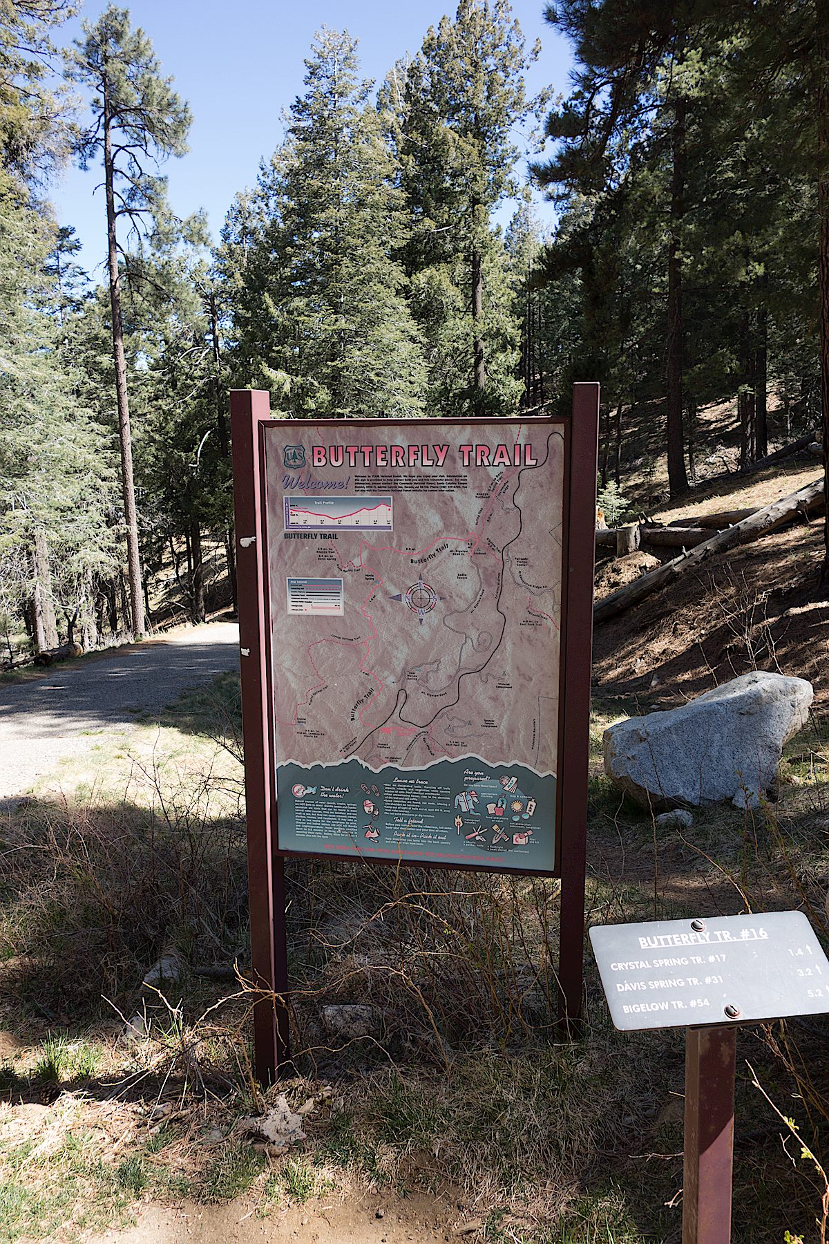 Trail map sign and small trail sign at the Butterfly Trailhead. April 2014.