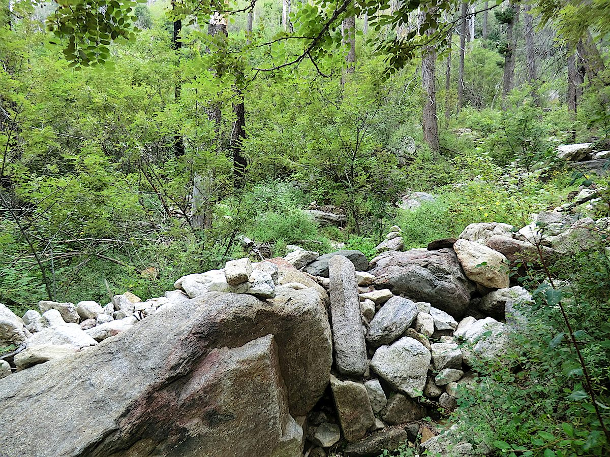 The rocky drainage - the trail crosses this drainage before the cabin site. September 2013.