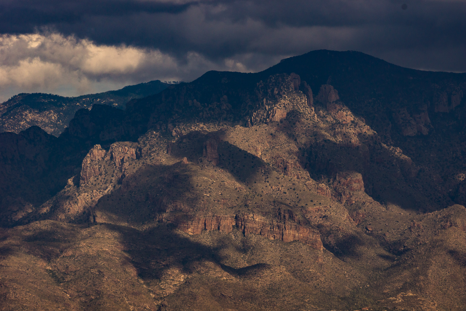 Shot from the slopes of Bren Mountain in the Tucson Mountains - Prominent Point disappearing into shadow, Finger Rock almost visible and light on the slopes above the North Campbell Trailhead.
