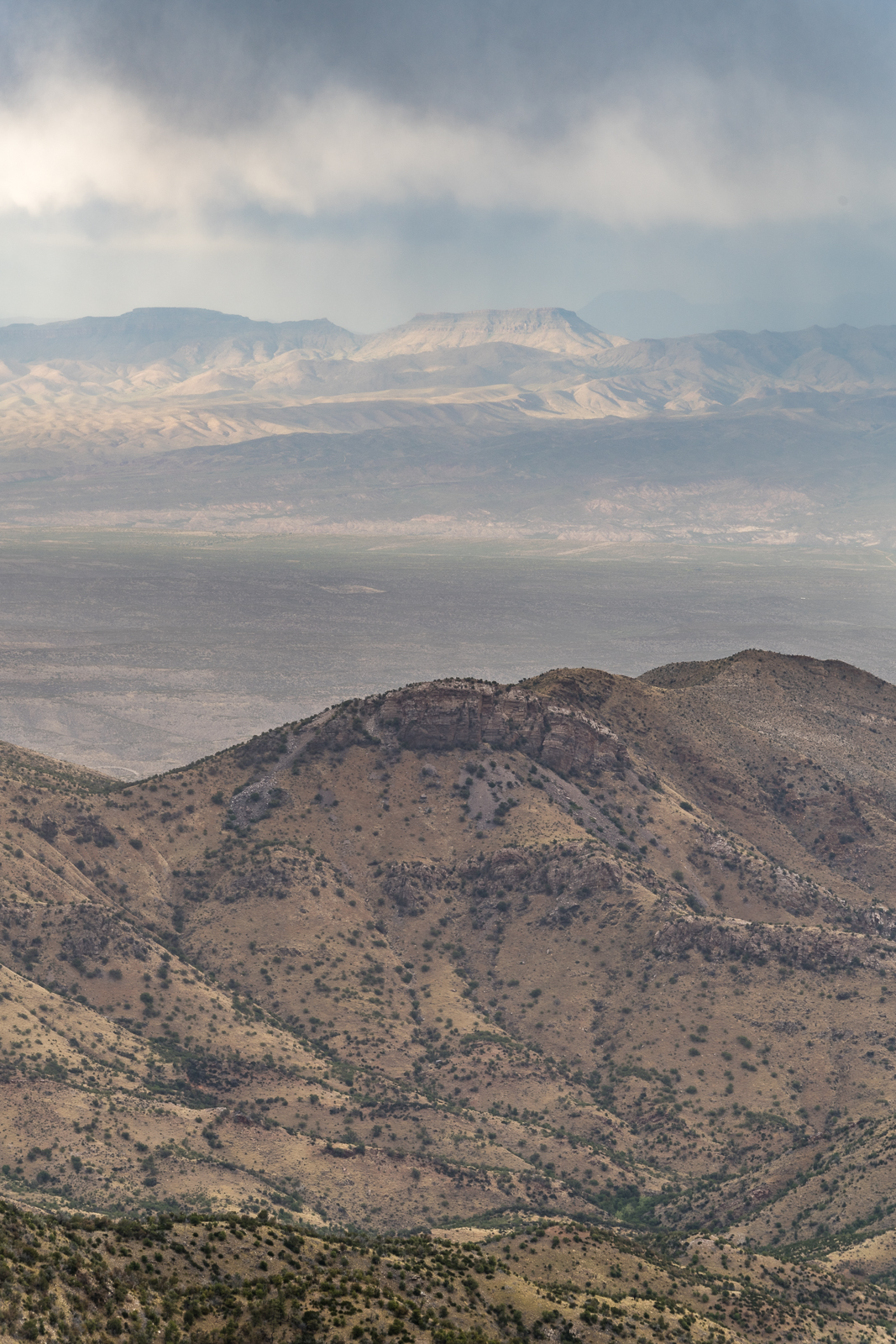 Looking over Peck Basin and Point 5817 and across the San Pedro River Valley to the Galiuro Mountains. April 2016.