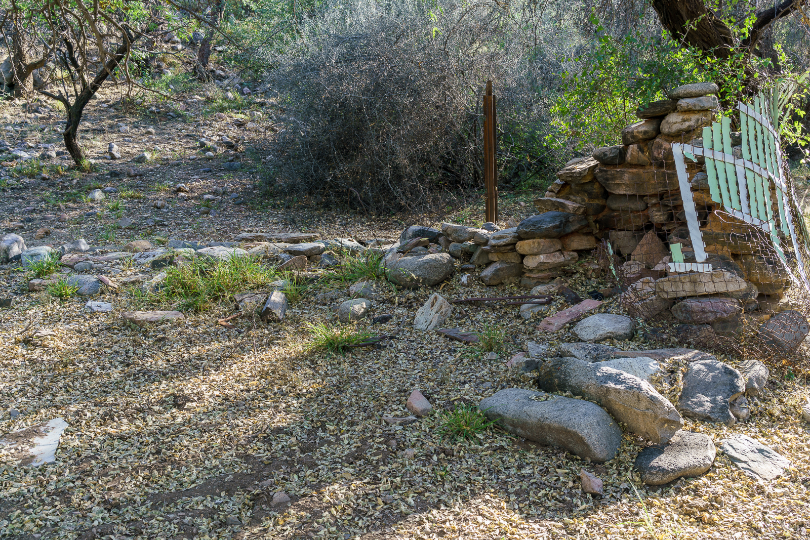 An old fireplace and fence near Alder Canyon. October 2016.