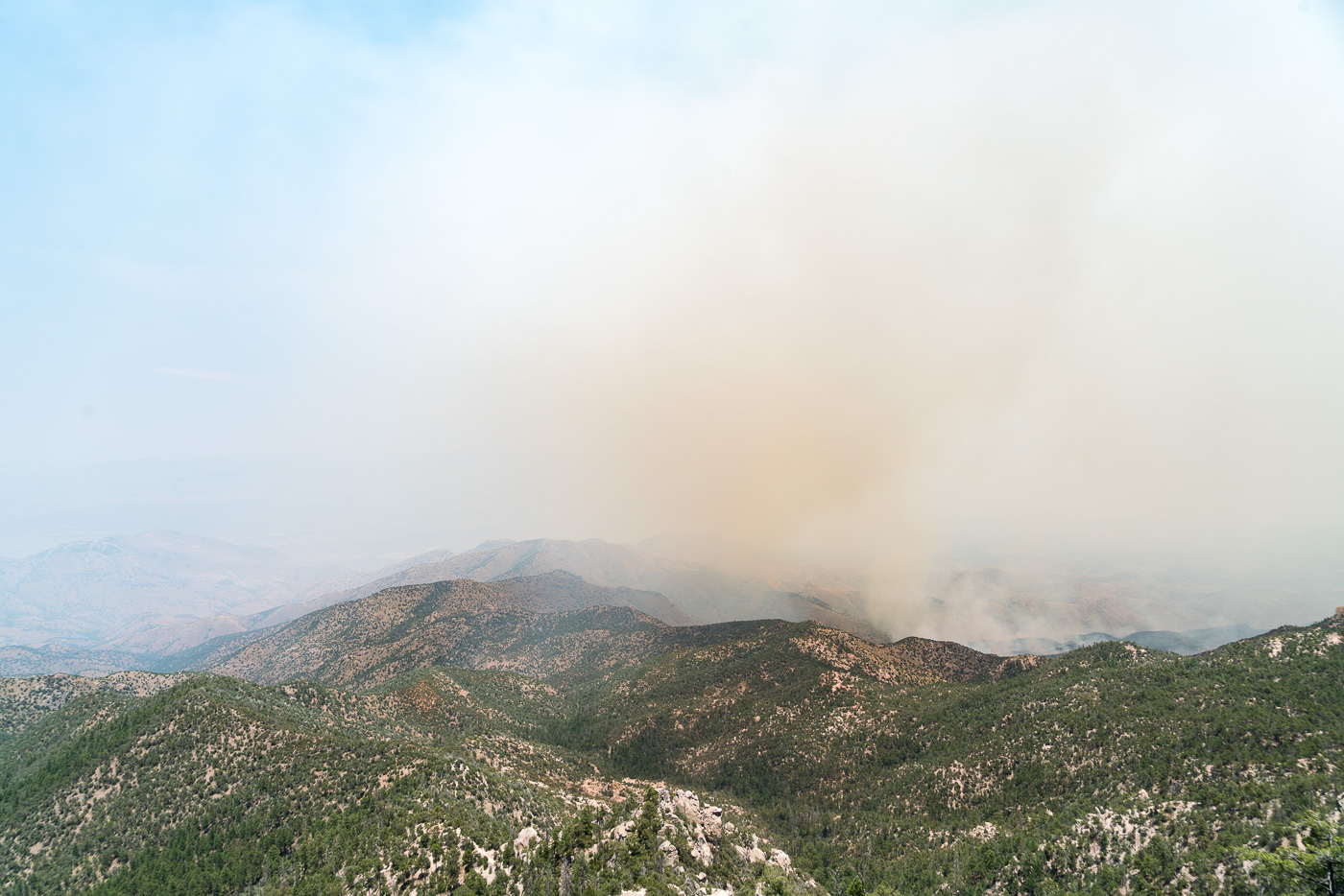 Looking down into a smoke obscured the San Pedro Valley - Edgar Canyon on the left. July 2017.