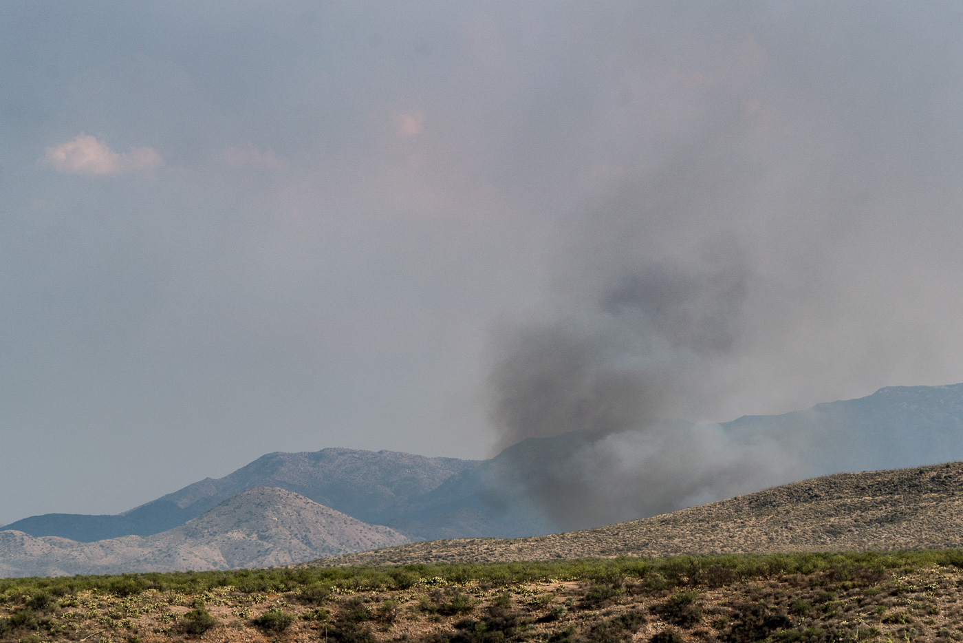 A plume of smoke east of the Evans Mountain area with Piety Hill on the left. July 2017.