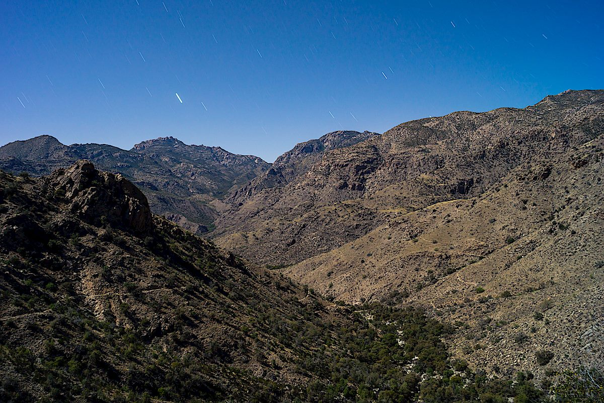 Night in the Santa Catalina Mountains - you can just make out the Palisade Trail making it's way down the hillside to it's junction with the East Fork Trail (visible on the left descending in shadow). April 2014.
