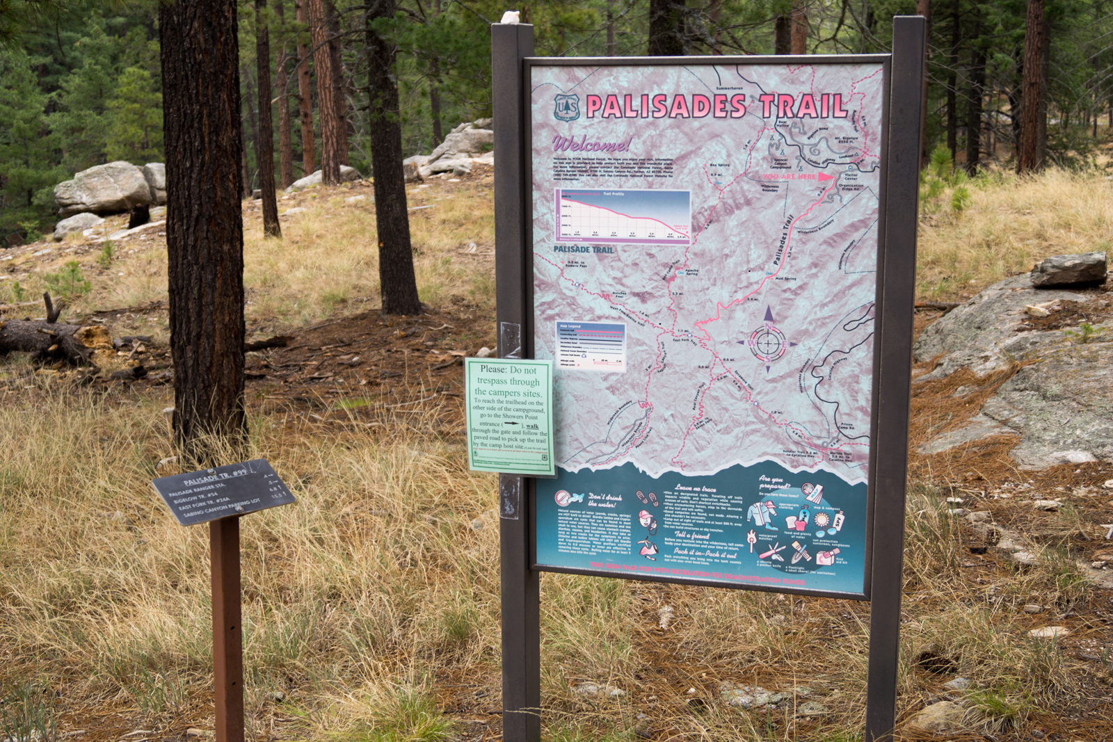 Trail Map Sign and trail sign at the Palisade Trailhead. July 2014.