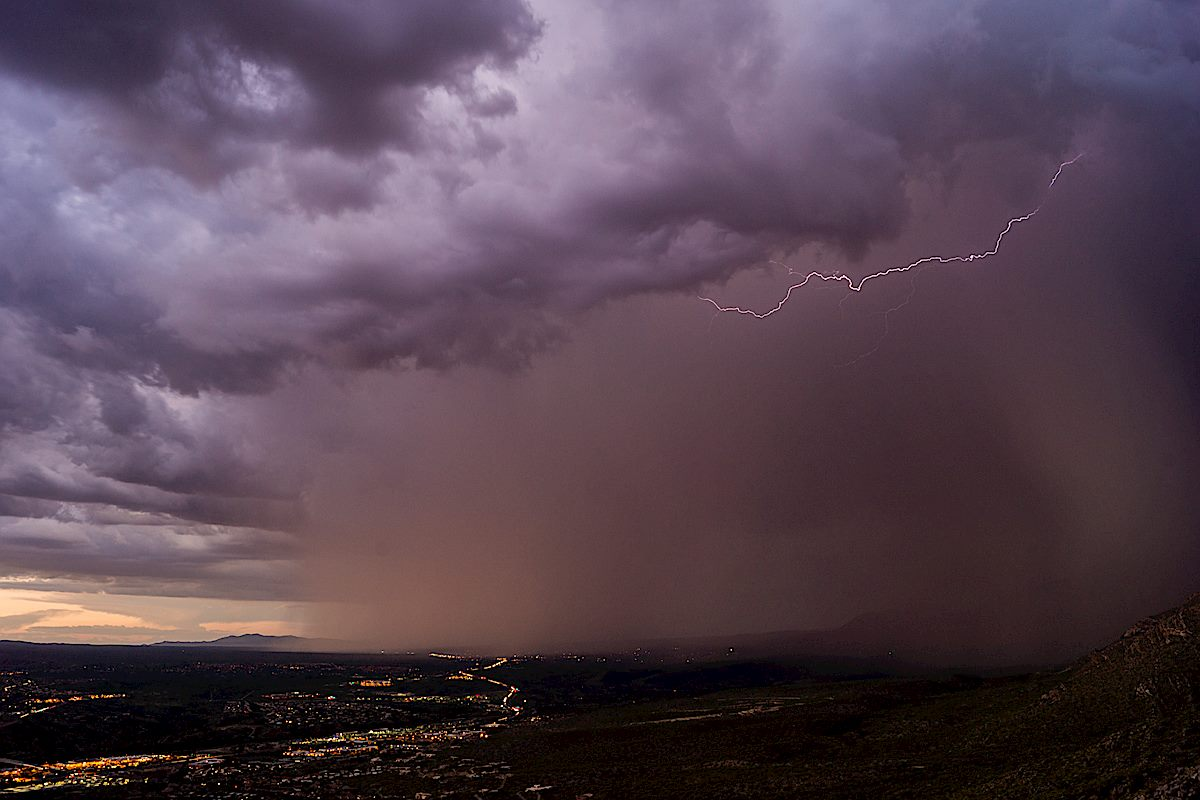 Lighting, clouds, rain and City Lights from a viewpoint off the Northwest Side Route. August 2014.